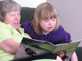 Alicia reads to her Grandma Barb